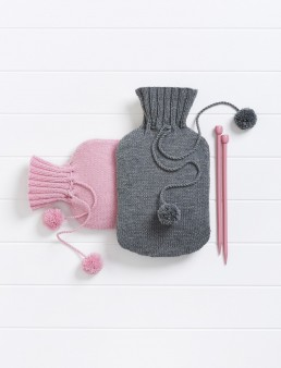 A still life photograph of two knitted hot water bottle covers by Melbourne advertising photographer Peter Rosetzky,