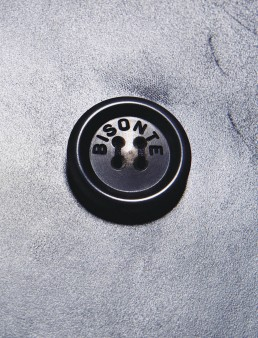 A close up photograph a button from a Bisonte leather jacket, this photo was part of an adverting campaign taken by Melbourne fashion photographer Peter Rosetzky